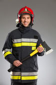 Firefighter posing with axe. — Stock Photo