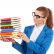 Smart woman holding stack of books — Stock Photo