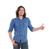 Handsome man showing thumb up — Stock Photo