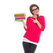 Female student pointing at a stack of books — Stock Photo