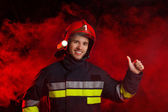 Fireman showing thumb up — Stock Photo