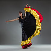 Dancer in a colorful dress — Stock Photo