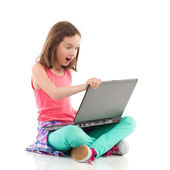 Surprised girl with a laptop — Stock Photo