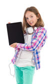 Teen girl presenting digital tablet — Stock Photo