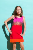 Little girl posing in colorful dress — Stock Photo