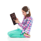 Little girl using a digital tablet. — Photo