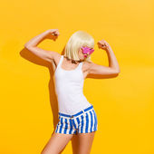 Funny blond woman flexing muscles — Stock Photo