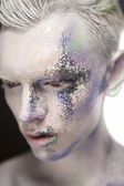 Young man with creative make-up — Stock Photo