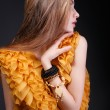 Profile of young woman in yellow dress — Stok fotoğraf