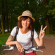 Stock Photo: Cyclist with victory sign
