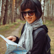 Woman tourist with map — Stock Photo