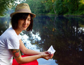 Hipster girl with a paper boat — Stock fotografie
