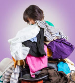 Woman holds a lot of clothes — Stock Photo