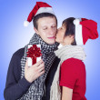Happiness couple with Christmas gift — Stock Photo