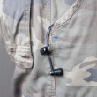 Ear phones hanging out of pocket — Stock Photo #31105093