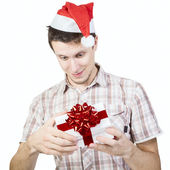 Smiling man opens gift box — Stock Photo