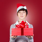 Woman holding gift box — Foto de Stock