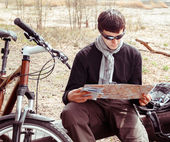 Man cyclist with map — Stock Photo