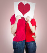 Loving couple with heart — Stock Photo