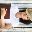Relaxing on a bench in the park — Stock Photo
