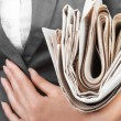Stock Photo: Newspaper about business close-up in hand