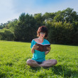 Young woman with diary in park — Stock Photo