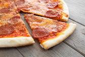Appetizing slice of pizza — Stock Photo