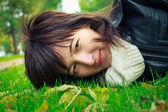 Happy woman lying on grass — Stock Photo
