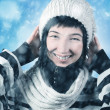 Happy young woman on blue snowy background — Stock Photo