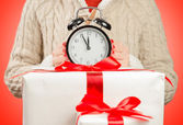 The clock on the gift boxes — Stockfoto