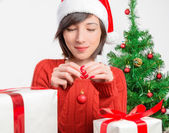 Woman holds christmas red ball — Stock Photo