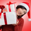 Woman is holding many presents — Stock Photo