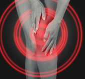 Massage knee joint — Stock Photo