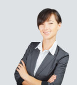 Happy young woman in suit — Stockfoto