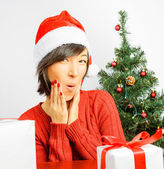Woman on a background of Christmas tree — Stock Photo