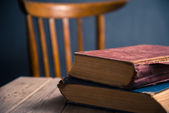 Two old books on a wooden table — Stock Photo