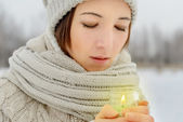 Portrait of woman with candle — Stock Photo