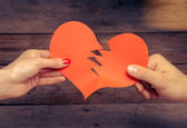 Broken red paper heart — Stock Photo