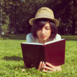 Woman reads a book on the meadow — Stock Photo