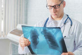 Doctor with x-ray picture — Stock Photo