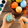 Child paints egg for Easter, focus on eggs — Stock Photo #41554063