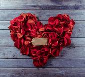 Rose petals in heart shape — Stock Photo