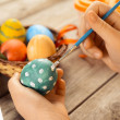 Female child paints Easter egg — Stock Photo #41617827