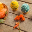 Easter colored eggs on a table — Stock Photo