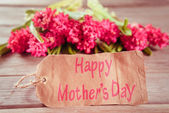 Hyacinths and a card with text Happy Mothers Day — Stock Photo