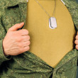 Military man opens his shirt, copyspace — Stock Photo #42308377
