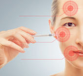 Woman holds a syringe near the face — Stock Photo