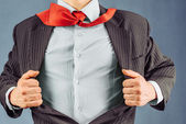 Business man opens his jacket — Stock Photo