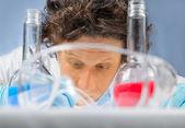 Scientist writes in the laboratory — Stock Photo