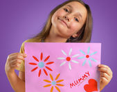Child with card for mother — Stock Photo